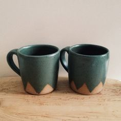 Handmade on the pottery wheel with speckled brownstone clay, these mugs are perfect for your morning tea or coffee.   Glazed in a matte Jade Green ,