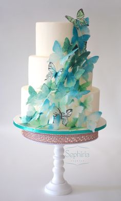 Wedding cake with a cascade of wafer paper butterflies, all hand-cut and coloured with Squires Kitchen colour dust.