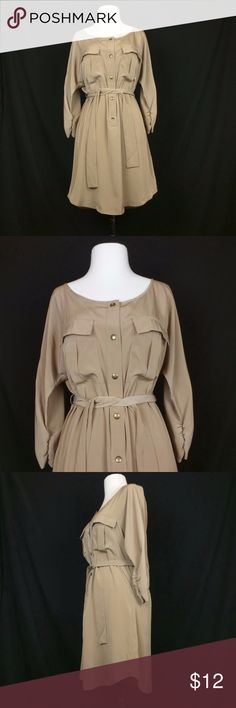 Apostrophe Light Brown Shirt Dress with Belt Flaw Item:  Shirt Dress  Size: Misses small  Brand: Apostrophe  Fabric Content: 100% polyester  Description:  Light brown Partially snapped front Dolman sleeves 3/4-length sleeves with gathered cuffs Matching belt  Measurements: Length: 34 inches, Chest: 42 inches, Waist: 38 inches, Hips: 38 inches, Sleeve length: 20 inches  Condition: Pre-owned condition. A small imperfection in fabric next to corner of left pocket. No stains, holes or tears…