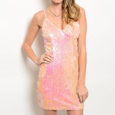 Pink/peach sequin dress This iridescent sequins dress features spaghetti straps, bodycon silhouette and a v-neckline.  100% polyester Dresses Mini