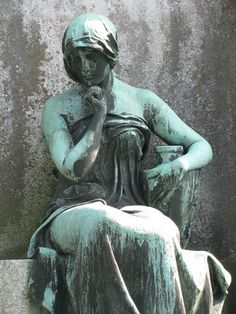 Cemetery Statue by Padeia, via Flickr