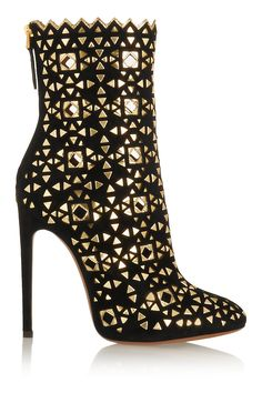 AlaïaEmbellished suede boots. Show-stopper; outfit needs to be one neutral colour to avoid being over the top.