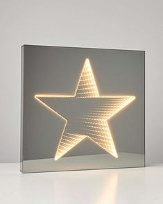 Make a statement in your living space with this infinity mirror light, with a star shape in white light. Whether you decide to hang it on your wall or display it on a table, this light is an eye-catching piece with a celestial feel. Infinity Lights, Infinity Mirror, Mirror With Lights, Wall Lights, Filter, Light Girls, Candle Shop, Heart Melting, Star Shape