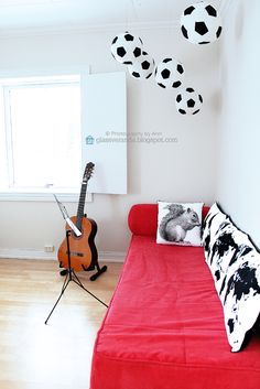 """A glimpse of my sons room, -a young teenager. A collection of footballs are hanging from the ceiling in the corner. Those balls are actually soft pillows """"floating"""" in the air with help from slim cotton ropes attached to small hooks in the ceiling! ;) Styling and photography by Ann, Glassveranda. (http://glassveranda.blogspot.com/)"""