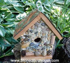 Handcrafted cedar birdhouse embellished with river rock, wine bottle corks, pinecones and antique drawer pull for perch.  Removable bottom for spring clean out. Roof is embellished with embossed panel in oxidized copper look. $55 plus shipping
