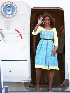 Michelle Obama wears a yellow and blue lace Preen midi dress