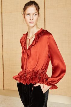 Crimson colored crinkle silk poet blouse. Perfect for the holidays. #ullajohnson #holidaydressing #silkblouse
