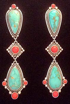 Earrings set with carico lake turquoise and red coral by Annelise Williamson