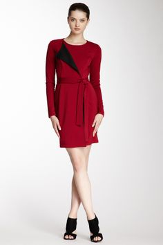 """Park Coat Dress with Contrast Lining in wine-black by emploi $212 - $95 at HauteLook. - Jewel neckline - Single flap lapel with contrast color - Side zip closure - Belted waist - Approx. 38"""" length - Made in USA Model's stats: - Height: 5'8"""" - Bust: 31"""" - Waist: 23.5"""" - Hips: 35"""" Model is wearing size S. Dry clean Content: 97% polyester, 3% spandex. Lining: 86% polyester, 12% rayon, 2% spandex."""
