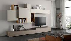 I mobili modello Ace da Chateau D'Ax sono stati creati specialmente per un living open space con colori olmo medio e laccato opaco senza maniglie.