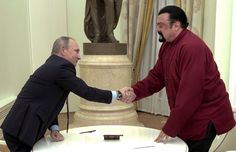 Russian President Vladimir Putin presented actor Steven Seagal with a Russian passport on Friday in a show of friendly relations with the U.S., according to NBC News.  Seagal signed his passport in front of Putin at a Kremlin ceremony.  Putin said he hoped it would serve as a symbol of how tense ties