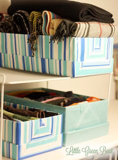 Organized closet: Shoe boxes wrapped in pretty matching paper to hold hats, scarves & gloves.