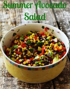 Summer Avocado Salad featuring black beans, corn, red peppers and a lime dressing.