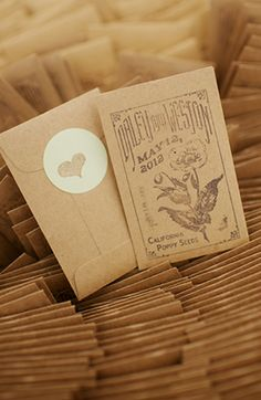 seed packets stamped kraft paper favors placed inside of mug with a peony stem... complete favor