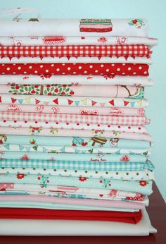 This fabric line would be PERFECT for Laila's room. Red, aqua & white with a touch of vintage. LOVE.