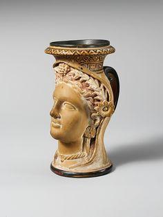 Terracotta oinochoe in the form of a woman's head  late 4th century BCE  Etruscan  The Metropolitan Museum of Art