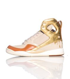 e3da8c406beb REEBOK High top women s senaker Lace up closure Mesh for breathability  Cushioned inner sole for comfort Gold accents