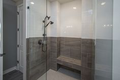 Owners Suite Shower: Contrasting ceramic tile  and subway tile shower surround with deco tile floor