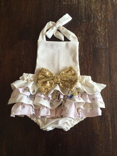 Belle ruffle romper is the perfect outfit for Spring/summer or any occasion! -Made with cotton fabric, and soft ponte de roma knit fabric. Gorgeous 7 inch sparkle big bow. Measurements: Up to 7lbs wei