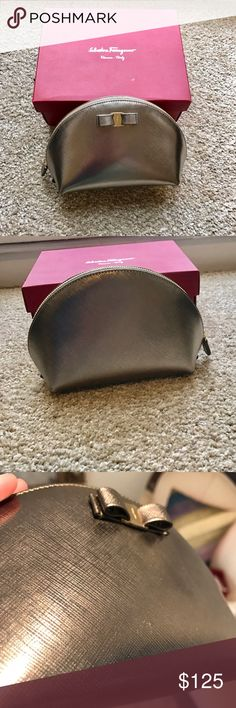 Salvatore Ferragamo Leather Dome Cosmetic Case Bag Beautiful cosmetic/makeup case/pouch by salvatore Ferragamo! The dome shape makes it very convenient for finding the items inside! It is in a gold metallic color and has the classic vara bow on the front. This is currently for sale at the Ferragamo outlet for $295, I am not sure what the original retail price was but most likely around $395. It has a few small marks on the front but they are hard to see with the color. Interior is in great…