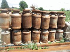 Old Vintage Rusty Milk Can Garden Decor Yard Art Garden Goodies These are old rusty milk cans which would be a nice garden accent. Measures 25 tall X