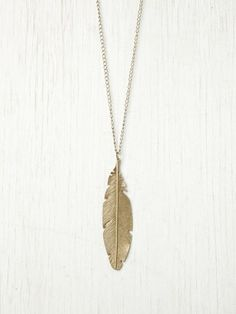 Feather Pendant Necklace. I got one in metallic color from Forever 21. Love this one too :)