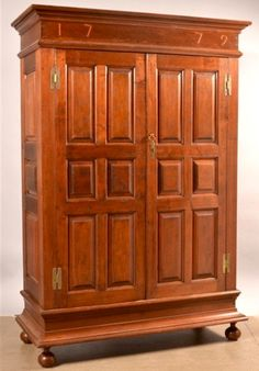 "Conestoga Auctions 12/3/16 lot 527.  Estimate: $2K - 4K. Realized: $3,770 (3,250).   Description Pa Chippendale Walnut Schrank with Inlaid Date of 1779. Ogee molded cornice over 2 raised panel doors with brass H hinges & raised panel sides, above a cove molded base supported by turned bun feet. 79''h. x 54''w. x 23-1/2""d. Condition: Good with Minor wear & restorations."