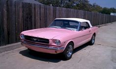 A guy bought this for his daughter - I want to be his daughter - 1964 convertible PINK mustang.