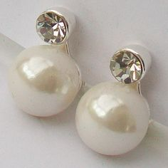 A elegant stylish classically simple pair clip-on earrings with a single faux pearl set off by another swirl off by a beautiful sparkling faceted Clip On Earrings, Pearl Earrings, Vintage Wedding Jewelry, Pearl Set, Stones And Crystals, Sparkle, Jewellery, Elegant, Stylish