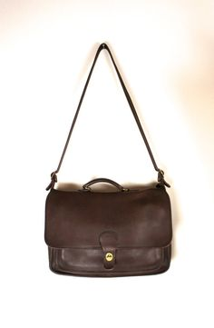 ***Reserved for Patty***    Designer: Coach  Style: Rambler Briefcase  Size: Large  Color: Mahogany Brown  Materials: Leather    Style Description: A
