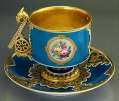 Exceedingly Rare Antique Porcelain Cup and Saucer in Neo-Russian Style, by the Imperial Porcelain Factory, St Petersburg, Russia, circa 1862, designed by Ivan Vasin, who was a master of stylization and developed new variations of Russian ornaments. His most outstanding Russian style project was the Romanov service made for the 250th anniversary of the Romanov dynasty rule in 1863.  This set is made from the same mould as the cups and saucers of the Romanov service but differently painted.