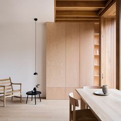 Loving the soft oak and ash wood surfaces and thoughtful cabinetry at the The Dewsbury Road extension by O'Sullivan Skoufoglou Architects. -  Photograph by @arorygardiner  - #plyroomsimplicity #interiordesign #minimalism #simplespaces #architecture