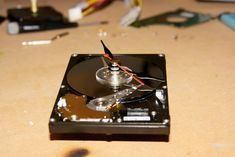 HDD Clock: This is a HDD clock I made from a dead external hard drive. I used a drive instead of a drive as in the UK it is very hard to find clock movements that have a long enough spindle to go all the way through. Clock Movements, Hdd, Turntable, Computer Hard Drive, Record Player