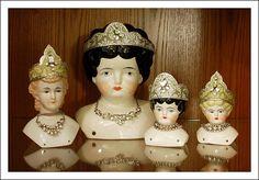 China Doll Heads with Holiday Tiara's by DarKaso, via Flickr