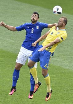 Italy's forward Pelle vies with Sweden's defender Andreas Granqvist during the Euro 2016 group E football match between Italy and Sweden at the...