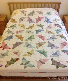 'Butterfly' Quilt on the bed in English Paper Piecing - Oh, love this!
