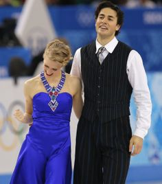 Kaitlyn Weaver reacts as she and Andrew Poje of Canada leave the ice after competing in the ice dance short dance figure skating competition...