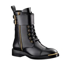 Louis Vuitton bottines militaire cuir http://www.vogue.fr/mode/shopping/diaporama/shopping-militaire-camouflage-armee-en-permission/13682/image/763511