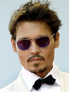 Johnny Depp with tux and sunglasses
