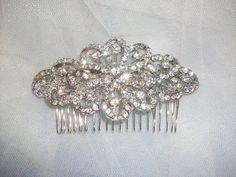 Hey, I found this really awesome Etsy listing at http://www.etsy.com/listing/75194024/crystal-bridal-hair-brooch-comb-or