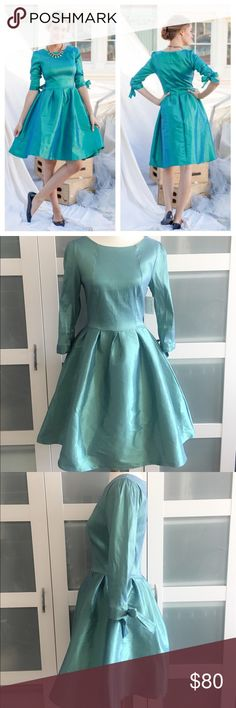 """Modcloth Shabby Apple nutcracker dress Modcloth Shabby Apple nutcracker dress. Iridescent green. Fit and flare style. Tie sleeves. Back zip. Vintage look. Size 8.  Measured flat  Pit to pit 16""""  Waist 13""""  Shoulder to hem 37.25"""" ModCloth Dresses"""