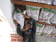 Earthbag Building: Using earthbags as ceiling insulation