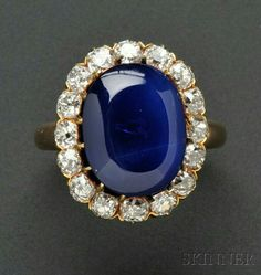antique Kashmir sapphire and diamond ring, set with a cabochon sapphire weighing 9.92 cts.