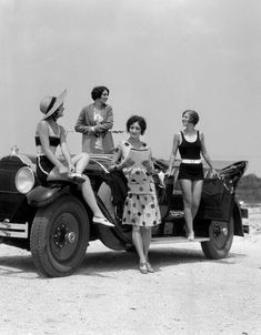 Four Women In Dresses And Bathing Suits Gathered Around Convertible Touring Car At Seashore//