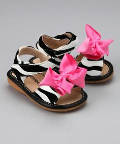 Take a look at this Black & White Zebra Hot Pink Bow Sandal by Laniecakes on #zulily today!