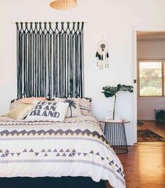 Get creative with your headboard options. A macrame wall hanging makes for the perfect alternative.