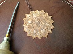 Hand engraved Mandala pendant. Personalized engraved jewelry.