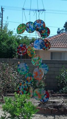 Windchime doubles as a sun catcher made from melted plastic beads in a cupcake pan at 400 degrees. Drill a hole in each and tie together with string, fishing line, whatever. We used a recycled cd with holes drilled in it to put all together. Fast fun project to do with kids!