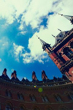 Broken clouds over St Pancras Station, London 19°C | 66°F