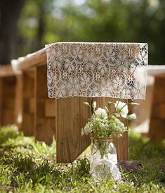 Wedding ceremony seating idea that would be gorgeous for a beach wedding. Rustic wooden benches with lace runner.